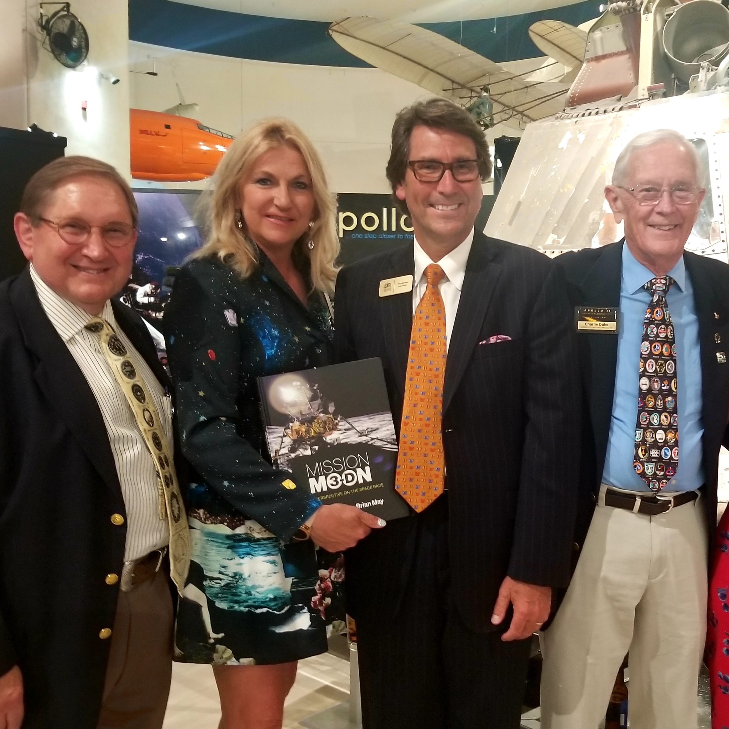 Dr. Perry and Judith Mansfield with Apollo 11, Charlie Duke, and CEO James Kidrick.