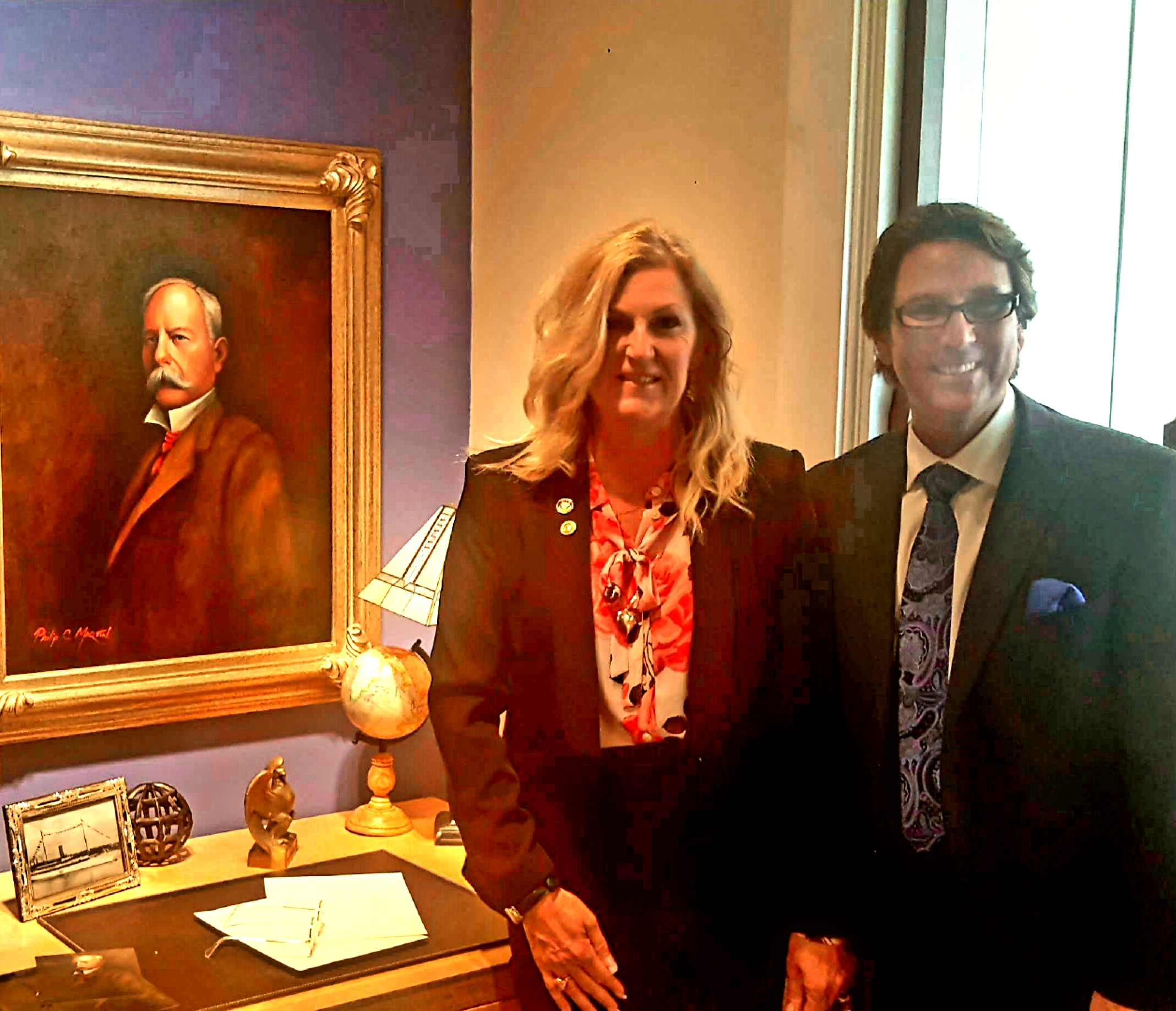 Dr. Perry and Judith Mansfield with an oil painting of John D. Spreckels