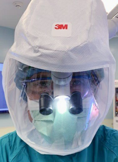 Dr. Perry Mansfield in full surgical gear for operating on covid patients