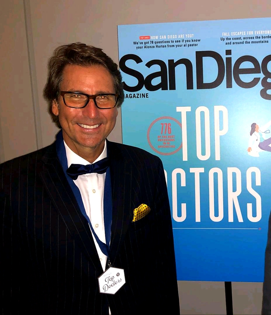 Dr. Mansfield in Front of San Diego Top Doctors Poster