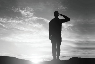 Silhouette of Saluting Soldier